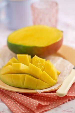 slashed: Sliced mango on a plate