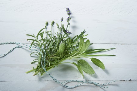 lavandula angustifolia: A fresh bunch of herbs featuring sage, rosemary, lavender, chives and savory