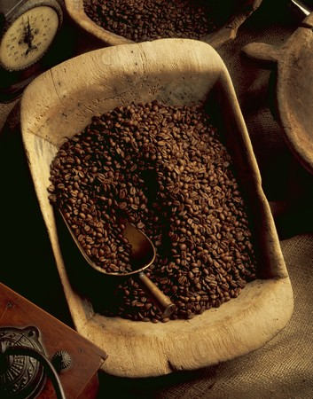 coffeebeans: Coffee beans in a wooden bowl with a scoop, an old coffee grinder and a pair of kitchen scales