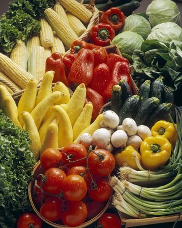 cocozelle: Fresh vegetables, corn cobs and lettuce at a market LANG_EVOIMAGES