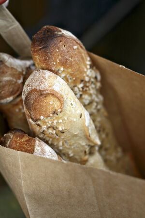 several breads: Baguettes in a paper bag