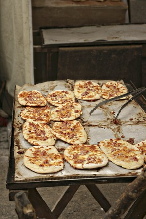 sold small: Dinnede (mini tarte flambée) at a market