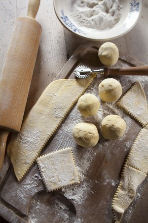pastry cutter: Dumpling dough, flour, a pastry cutter and a rolling pin LANG_EVOIMAGES