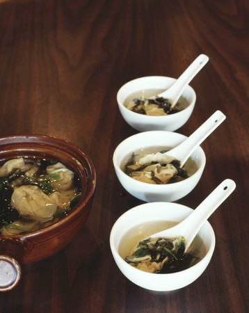 clarifying: Steamed wontons filled with pork in a clear broth