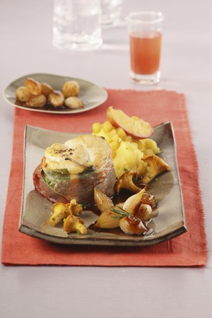 saltwater pearl: Fried monkfish medallions wrapped in bacon served with pearl onions on a bed of mashed apples and potatoes