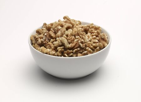 noone: Walnuts in a white bowl
