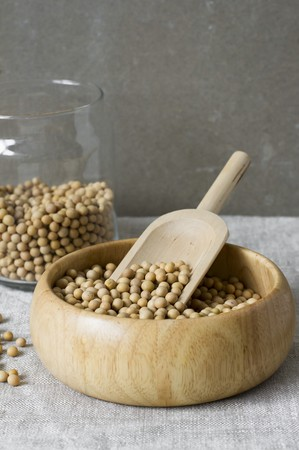 soya beans: Soya beans in a wooden bowl with a scoop