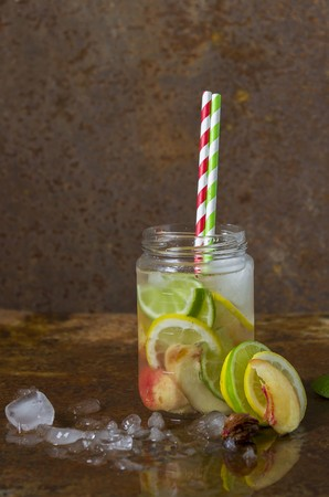 soda pops: Homemade lemonade in a screw-top jar with straws LANG_EVOIMAGES