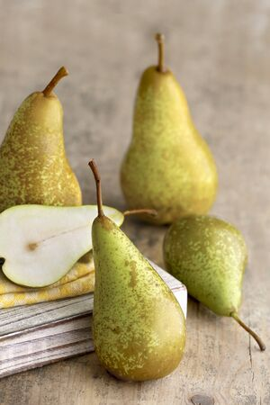 greenness: Pears on a light wooden surface