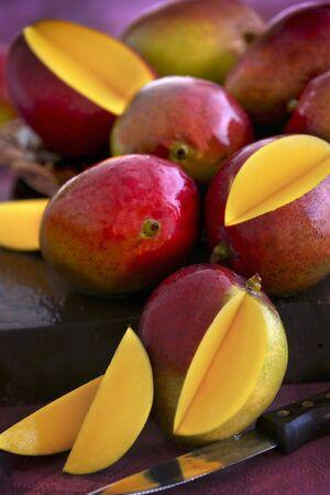 slashed: A stack of mangoes, some sliced LANG_EVOIMAGES