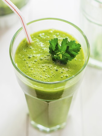 greenness: A gGreen smoothie garnished with parsley