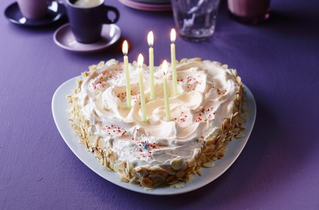 heartshaped: A heart-shaped cake with burning candles for birthday