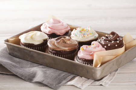 jimmies: A tray of decorated cupcakes