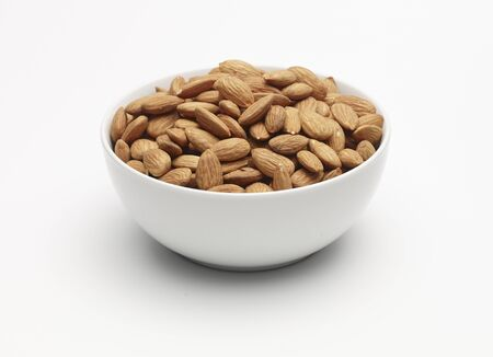 unpeeled: Unpeeled almonds in a white bowl