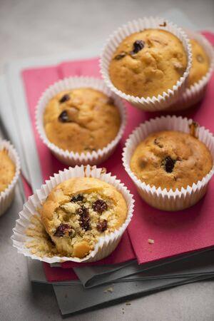 vaccinium macrocarpon: Cranberry muffins on a pink napkin LANG_EVOIMAGES
