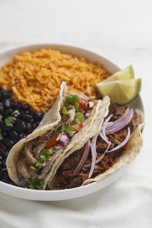fillings: Tacos with various meat fillings, black beans and tomato rice