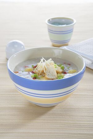 beancurd: Rice porridge with tofu, ginger and spring onions (Hong Kong) LANG_EVOIMAGES