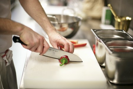 chilli pepper: A chilli pepper being sliced