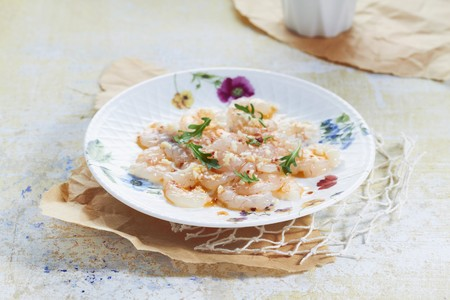 arugola: Prawn carpaccio with garlic, pepper and rocket LANG_EVOIMAGES