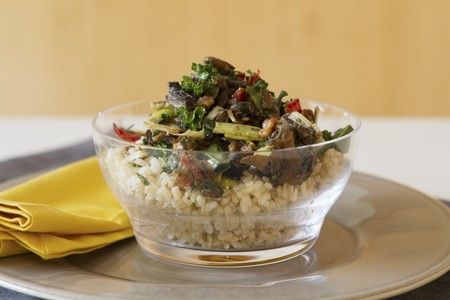giant mushroom: Rice salad with Portobello mushrooms, roasted peppers, dried tomatoes, kale and walnuts LANG_EVOIMAGES