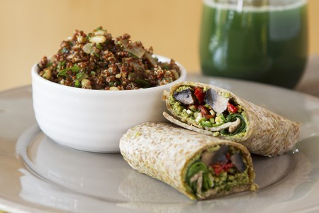 arugola: Wholemeal wraps filled with portobello mushrooms, pesto, dried tomatoes and courgettes next to a bowl of quinoa with cabbage and coconut milk LANG_EVOIMAGES
