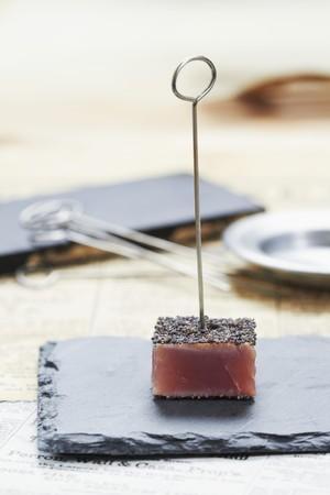 tunafish: A tuna fish cube with poppyseeds (Japan)