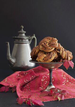 pastes: Chocolate and cinnamon buns on a pewter stand