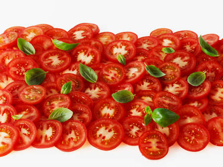 tomato slices: Tomato slices and basil leaves
