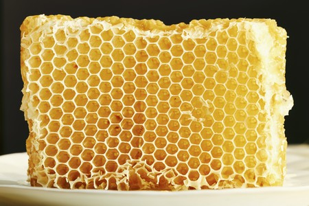 whiteness: Honeycomb on a white plate