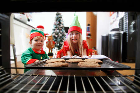 provenance: Two children baking Christmas biscuits