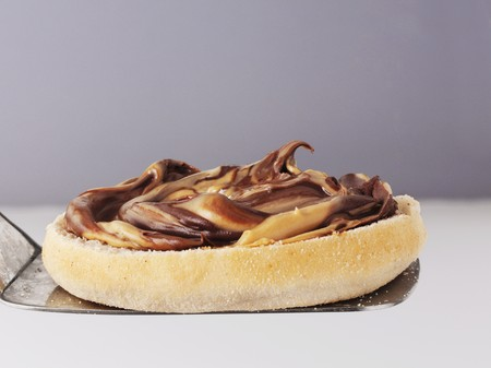 sandwich spread: An English muffin topped with chocolate and caramel spread LANG_EVOIMAGES