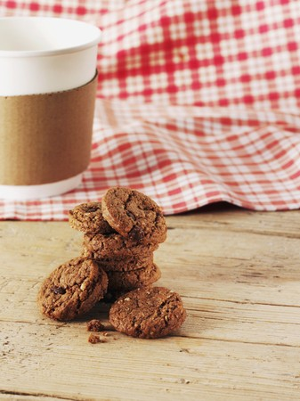 choco chips: Chocolate chip cookies in front of a coffee cup