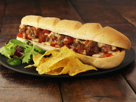 hoagie: A meatball sub with cheese and crisps