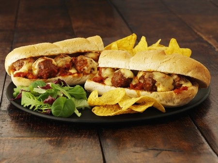 hero sandwich: A meatball sub with cheese and crisps