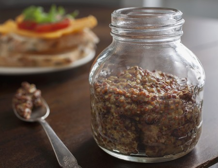 wholegrain mustard: A jar of wholegrain Dijon mustard
