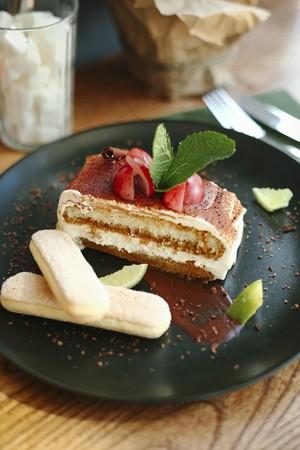 mascarpone: A portion of tiramisu with fruits and mint