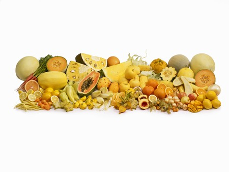 Yellow fruit and vegetables in front of a white background LANG_EVOIMAGES