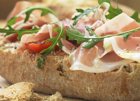 panino: A panini with prosciutto, tomatoes and rocket