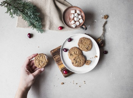 marshmellow: Gluten-free biscuits on a plate with a cup of hot chocolate with marshmallows behind it LANG_EVOIMAGES