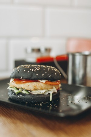 vintage: Black burger with cheese, tomatoes and lettuce LANG_EVOIMAGES