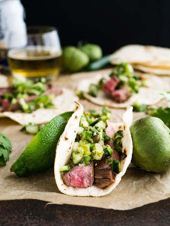 gallo: Tacos with flank steak, Pico de Gallo Verde, limes and tomatoes