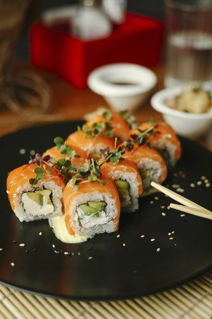 Sushi rolls with salmon, avocado, fresh cheese and herbs LANG_EVOIMAGES