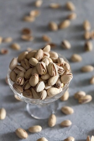 Pistachios in a crystal glass bowl