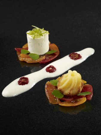 A mini gugelhupf and a serving of mousse on candied tomatoes LANG_EVOIMAGES