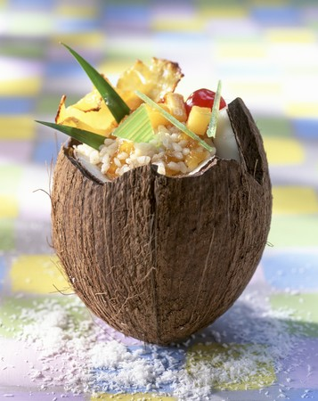 Rice pudding with candied fruits in a coconut husk LANG_EVOIMAGES