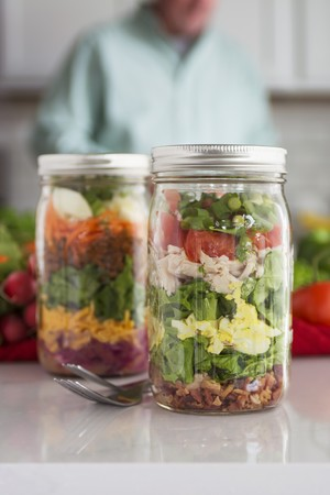 go inside: Layered salad in glass with spinach, beans, cheese and egg