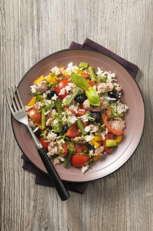 tunafish: A salad with tuna, rice, tomatoes, beans, peppers and olives