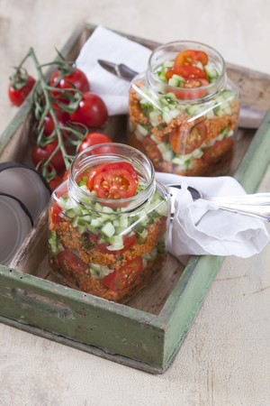 midday: Bulgur wheat salad with pomegranate syrup, onions, cucumber, tomatoes, parsley and mint in a glass jar