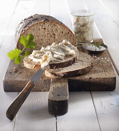 Traditionally baked bread with crackling fat and salt on a wooden board LANG_EVOIMAGES