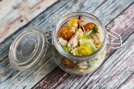 go inside: A pasta salad in a glass jar with tomatoes, chicken strips and pecorino LANG_EVOIMAGES